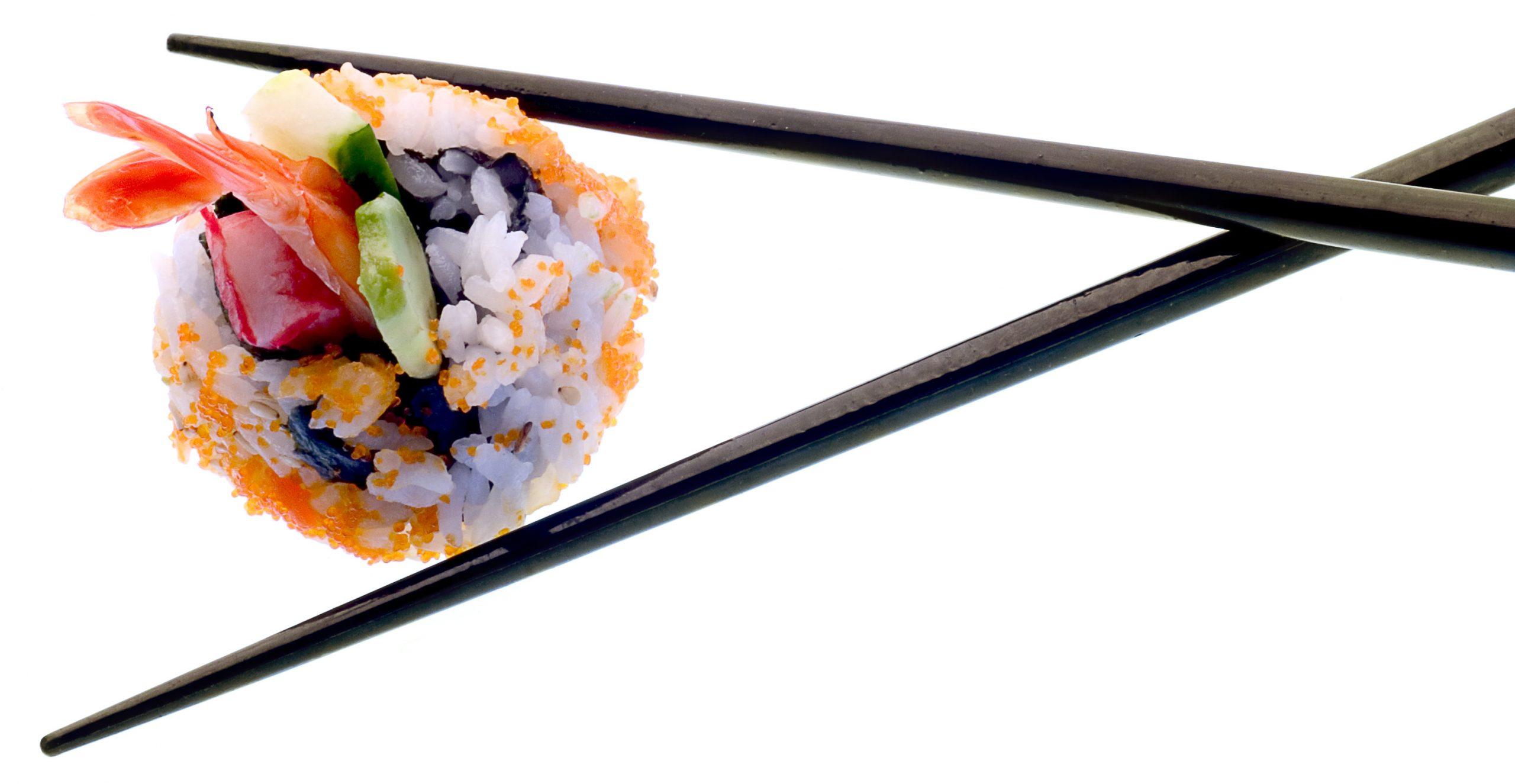 Sushi and chopsticks isolated on white