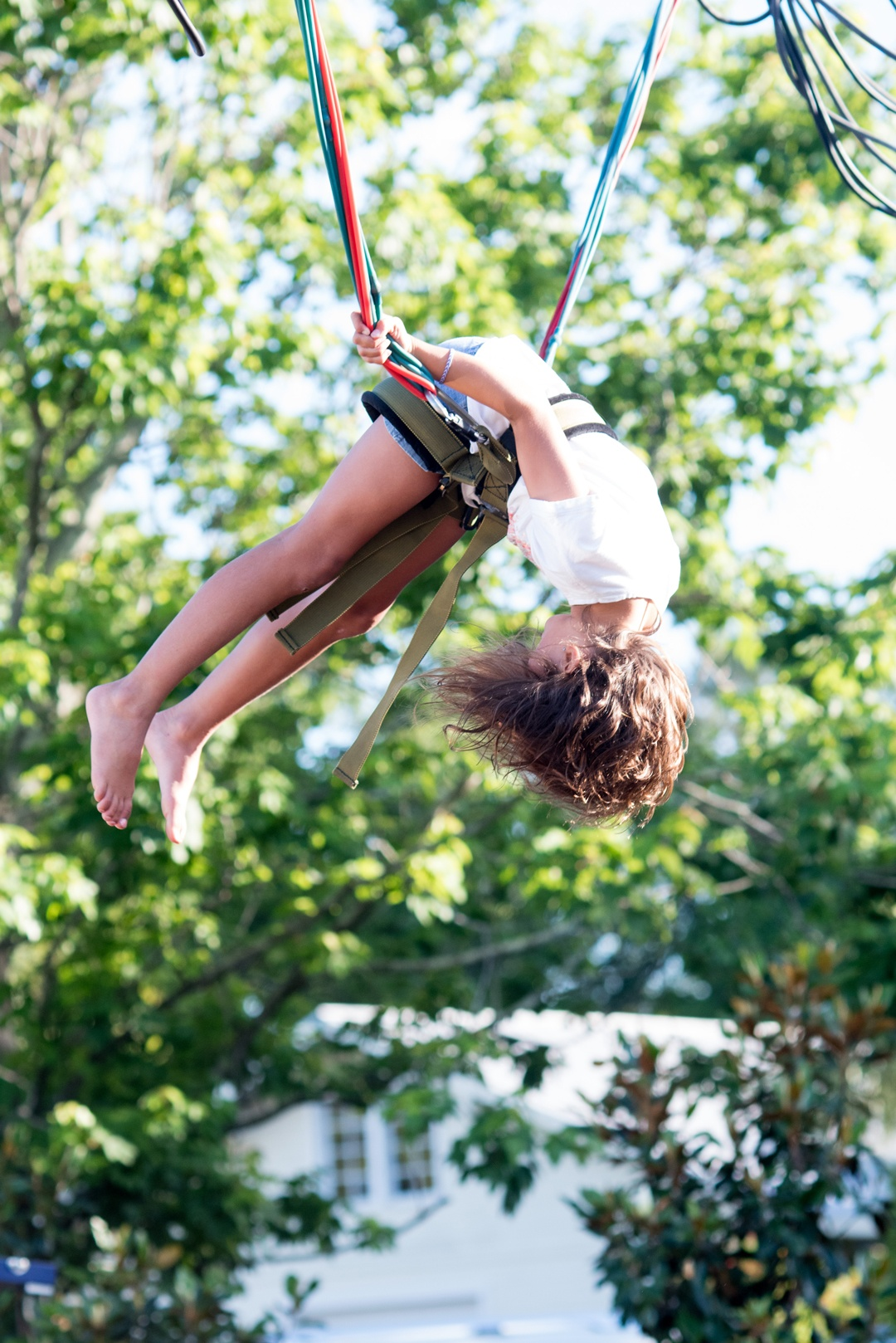 girl hanging on a rope